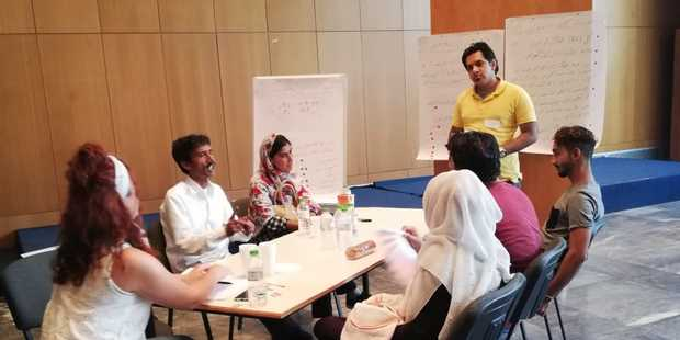 Validating profiling findings by reporting back to communities, with facilitators from the displaced and local population